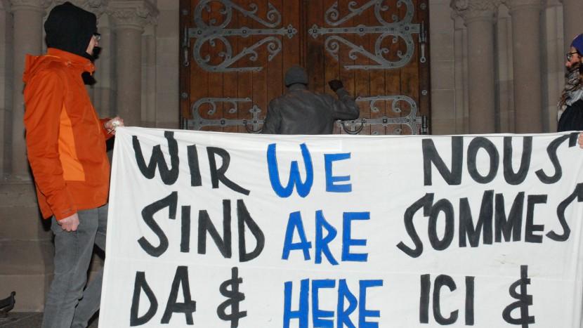Protest gegen die Asylpolitik in der Matthäuskirche Basel.